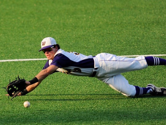 Wylie shortstop Austin Smith dives for a groundball