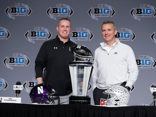 Northwestern head coach Pat Fitzgerald, left, and Ohio State head coach Urban Meyer pose at a press conference before the Big Ten Championship Game in Indianapolis last year.