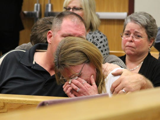 Donna Ritchey receives comfort from her husband Wednesday at a sentencing hearing for her son-in-law, who murdered her daughter in 2014.