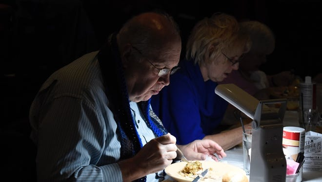 Garden City residents Al and Marcia Renaud enjoys their turkey dinners Monday evening at the Sports Venue in Garden City.