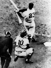 Bobby Thomson of the New York Giants hits a pennant-winning,