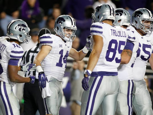 Teammates congratulate Kansas State wide receiver Curry Sexton (14) after scoring a touchdown against TCU on Nov. 8.