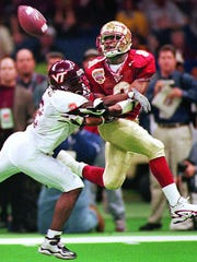 Peter Warrick tries to haul in a pass against Virginia Tech.