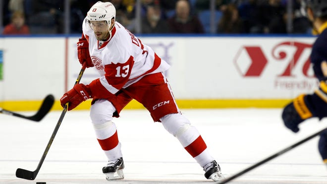 Detroit Red Wings center Pavel Datsyuk takes the puck into the Buffalo Sabres' zone.