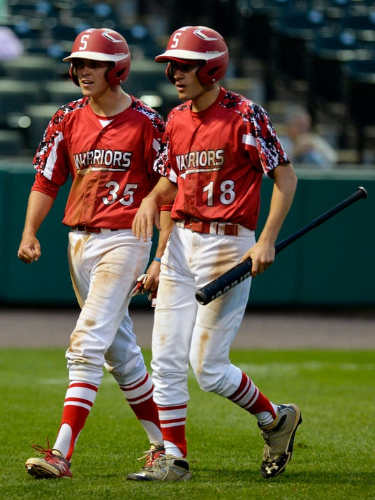 Susquehannock's Connor Hood (35) and Alex Palmer (18) return to the dugout together after each scored a run to take the lead over West York in the second inning of a YAIAA baseball semifinal on Wednesday, May 14, 2014, at Santander Stadium. Susquehannock defeated West York 4-3 to advance to the YAIAA final. Chris Dunn Ñ Daily Record/Sunday News