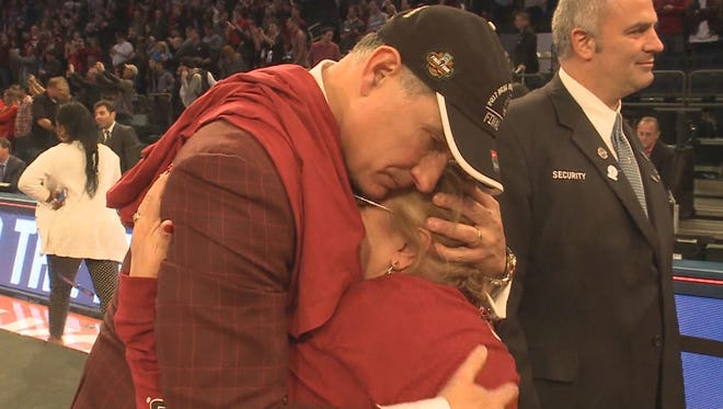 South Carolina coach Frank Martin gives his mother, Lourdes, a long hug after the Gamecocks beat Florida to clinch a trip to the Final Four.