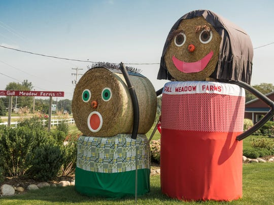 Decorated hay bales greet you at the entrance of Gull Meadow Farms.