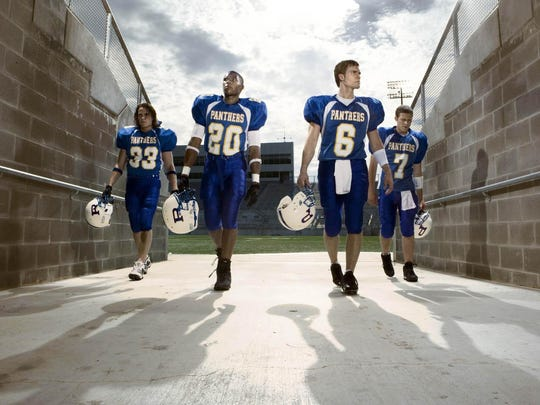 """From left, Taylor Kitsch as Tim Riggins, Gaius Charles as Brian """"Smash"""" Williams, Scott Porter as Jason Street and Zach Gilford as Matt Saracen appear in a scene from the NBC television series """"Friday Night Lights."""""""