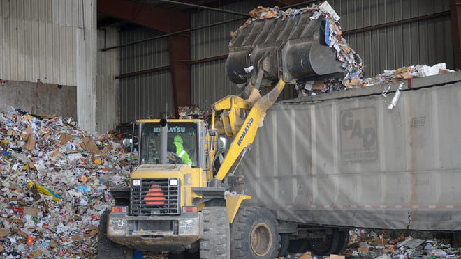 Recyclable materials are loaded into a semi trailer at the Brown County Resource Recovery Facility, for transfer to the Tri-County Recycling Faciity, Tuesday, December 2, 2014.
