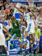 Antravious Simmons (right) and his FGCU teammates need to stop Stetson's quick guards (like Divine Myles, pictured) from attacking the lane consistently when the Eagles open ASUN play in DeLand at 4 p.m. Saturday.