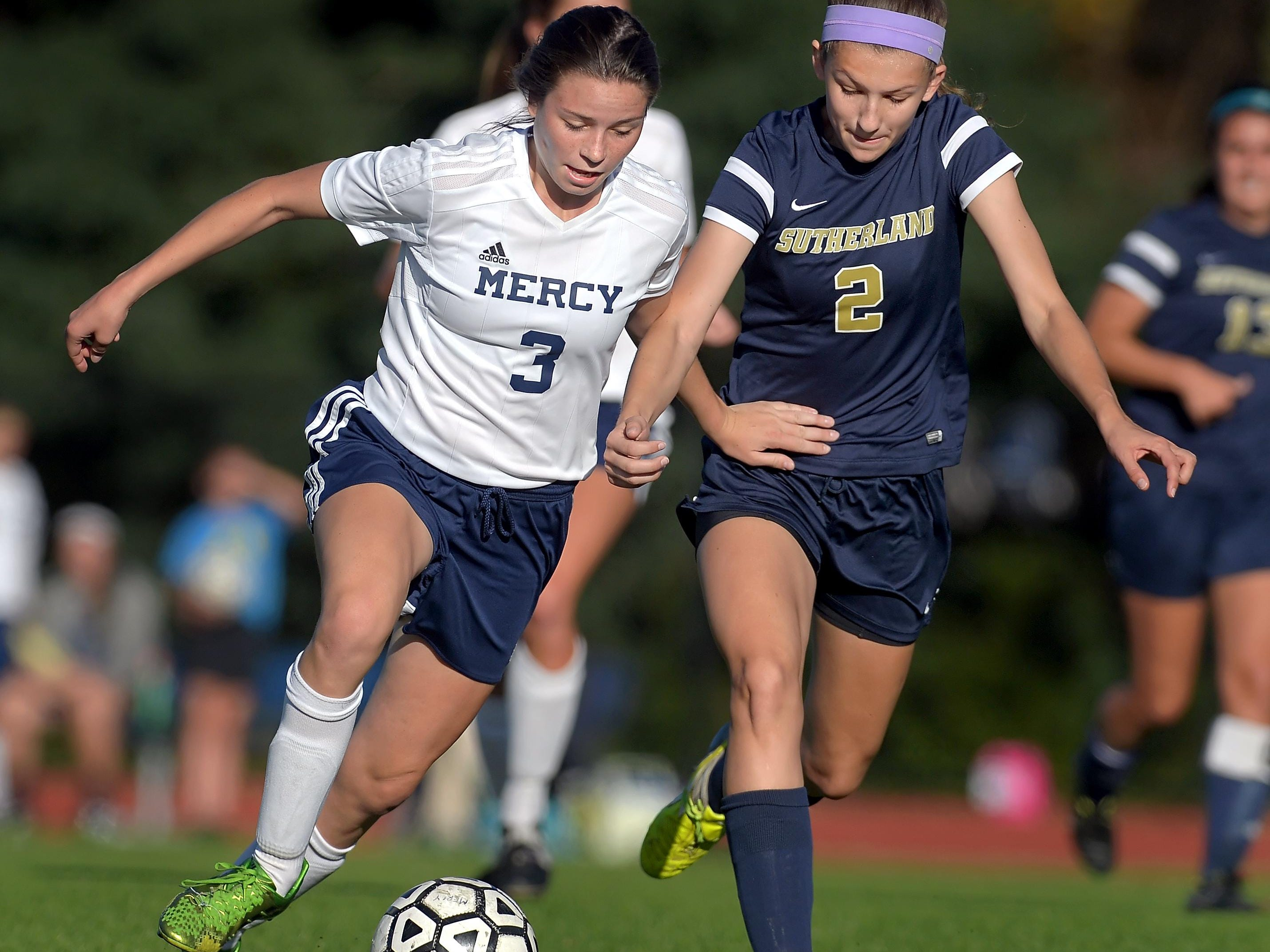 Mercy's Emily Wade, left, and Pittsford Sutherland's Claire Anvelt battle for position on the ball at Our Lady of Mercy High School on Monday. Pittsford Sutherland beat Mercy, 2-0.