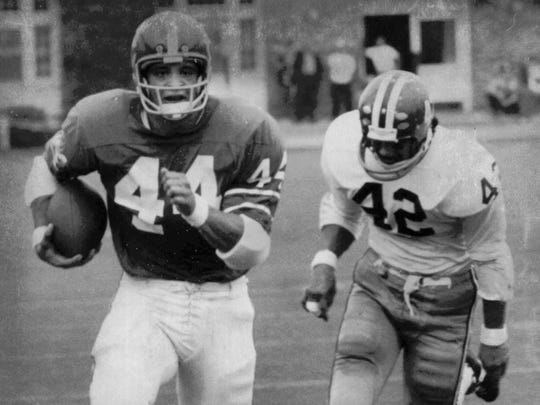 Cornell University running back Ed Marinaro races for the end zone with Harvard defensive back David Ignacio in pursuit in Ithaca, N.Y. Oct. 16, 1971.