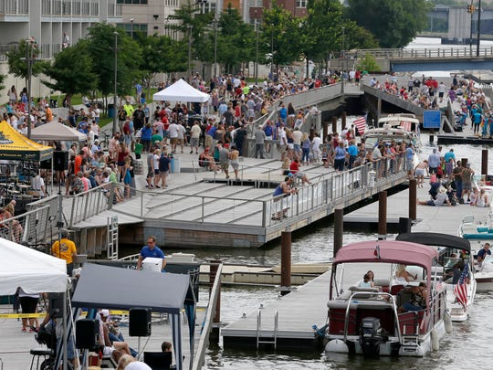 CityDeck along the Fox River was jammed during the Fire Over the Fox festivities July 4, 2016.