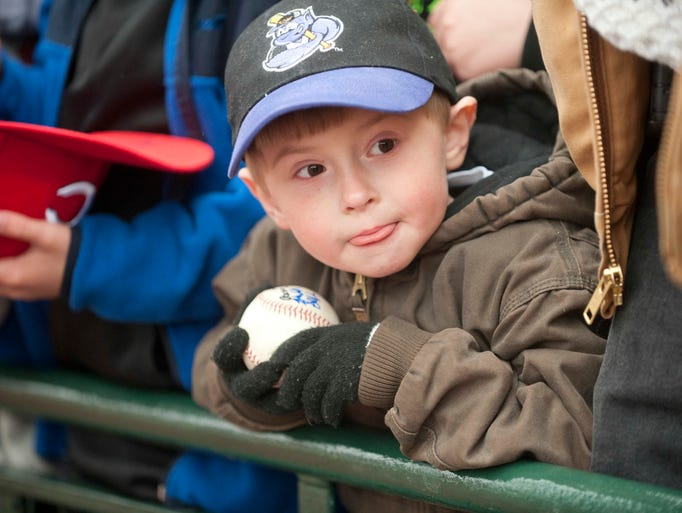 Silas Tackett, age 5, of Mt. Eden, Ky., waits patiently to get his baseball autographed as the Louisville Bats play their major league team, the  Cincinnati Reds in an exhibition game at Louisville Slugger Field. March 29, 2014