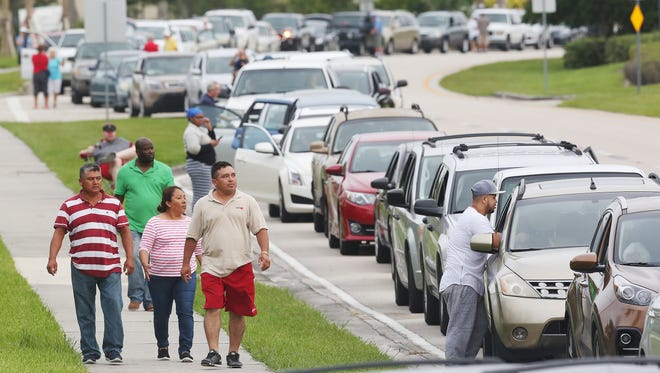 Thousands of people line up Sept. 9, 2017 to enter a hurricane shelter at Germain Arena in Estero, Fla. The line is close to two miles long. Residents througout Florida are seeking last minute shelter in advance of Hurricane Irma. Florida is in the path of the Hurricane which may come ashore at category 4.