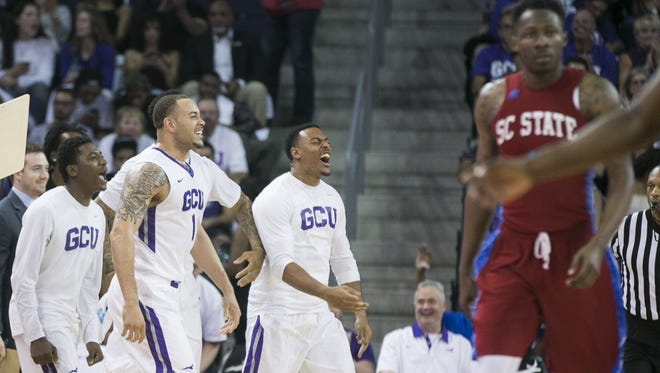 GCU's bench erupts after a scoring run and a SC State timeout during the first half at Grand Canyon University in Phoenix, Ariz. on Monday, March 14, 2016.