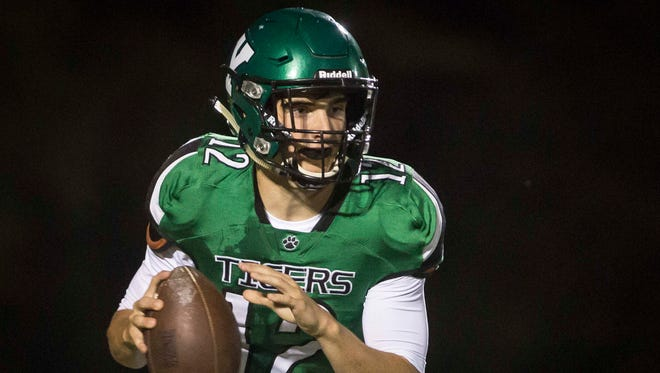 Yorktown's Reid Neal looks to pass against New Castle last season. Neal and the Tigers are looking for their first winning season since 2014.