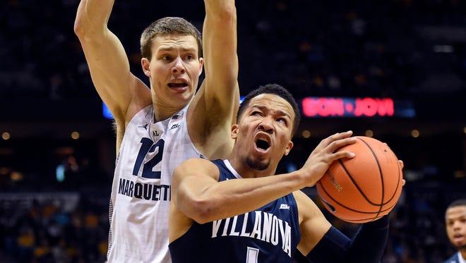 Villanova Wildcats guard Jalen Brunson (1) drives for the basket against Marquette Golden Eagles center Matt Heldt.