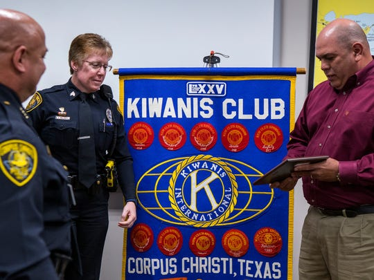 Corpus Christi Police Chief Mike Markle (from left), Senior Officer Samantha Baldwin and Mike Silva, president of the Corpus Christi Chapter of Kiwanis Club International, gather as Baldwin is presented with the club's Police Officer of the Year award at the Congressman Solomon P. Ortiz International Center on Thursday, April 26, 2018.
