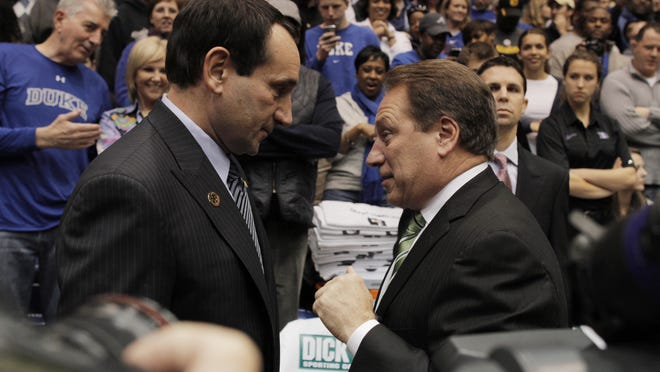 Dukecoach Mike Krzyzewski chats with Michigan State coach Tom Izzo before their game in 2010 at Cameron Indoor Stadium. Izzo is 1-8 against Krzyzewski and Duke. Krzyzewski has built an empire in Durham, N.C., winning four national titles.