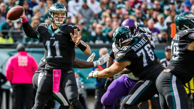 Philadelphia Eagles quarterback Carson Wentz (No. 11) delivers a pass in the first quarter of the Eagles 21-10 win over the Vikings at Lincoln Financial Field in Philadelphia on Sunday afternoon.