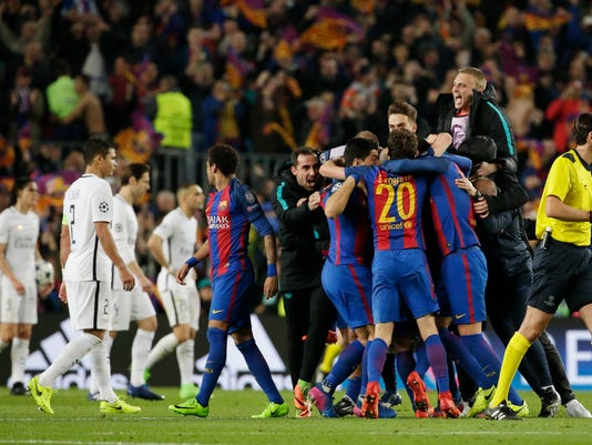 Barcelona players celebrate at the end of the Champions League round of 16, second leg soccer match between FC Barcelona and Paris Saint Germain at the Camp Nou stadium in Barcelona, Spain, Wednesday March 8, 2017. Barcelona won 6-1. (AP Photo/Emilio Morenatti)