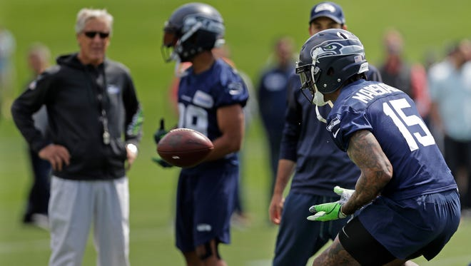 Brandon Marshall catches a football during his first workout with the Seahawks on Wednesday.