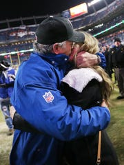 Colts head coach Chuck Pagano gives his wife, Tina