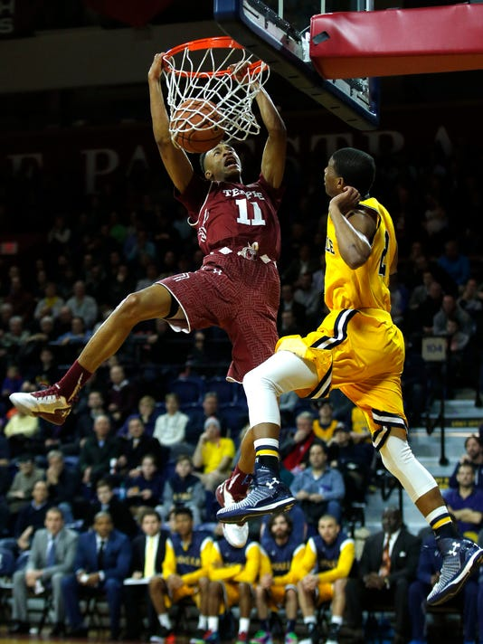 Temple's Trey Lowe is fouled while dunking against La Salle's Amar Stukes during the first half of an NCAA college basketball game Wednesday, Jan. 20, 2016, in Philadelphia. (Yong Kim/The Philadelphia Inquirer via AP)