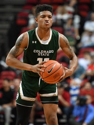CSU's Prentiss Nixon looks for an open teammate to pass the ball to during Saturday's win over UNLV in Las Vegas.