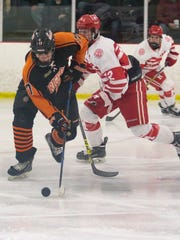 Brighton's Adam Conquest brings the puck up the ice