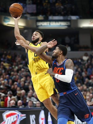 Indiana Pacers guard Cory Joseph (6) shoots around Oklahoma City Thunder forward Paul George (13) in the first half of their game at Bankers Life Fieldhouse Wednesday, Dec 13, 2017.