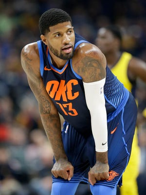 Oklahoma City Thunder forward Paul George (13) looks over at the Pacers fans in the first half of their game at Bankers Life Fieldhouse Wednesday, Dec 13, 2017.