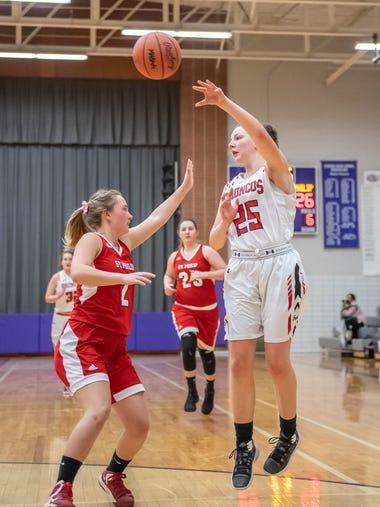Bellevue's Berit Ernst (25) goes for the hoop during
