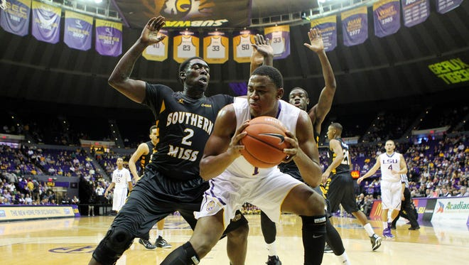 LSU forward Jarell Martin (1) is defended by Southern Miss Golden Eagles guard Matt Bingaya (2) in the first half at the Pete Maravich Assembly Center.