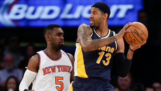New York Knicks' Tim Hardaway Jr. (5) defends Indiana Pacers' Paul George (13) during the first half of an NBA basketball game Wednesday, April 8, 2015, in New York. (AP Photo/Frank Franklin II)