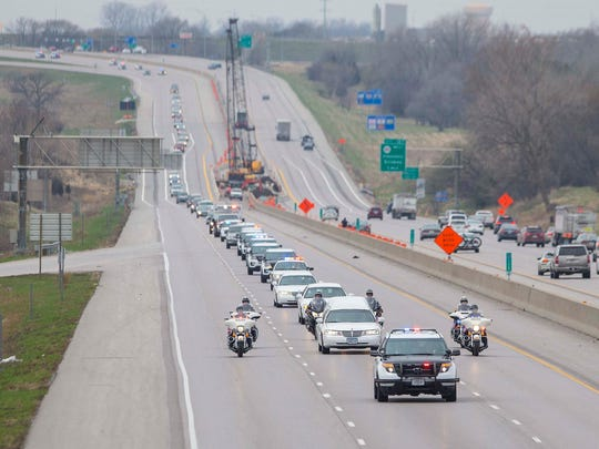 The funeral procession for Des Moines police officer Susan Farrell passes eastbound on I-80/I-35  Wednesday March 30, 2016, after services at Lutheran Church of Hope in West Des Moines.
