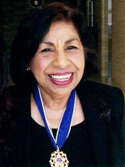 Sylvia Mendez poses with her Medal of Freedom.