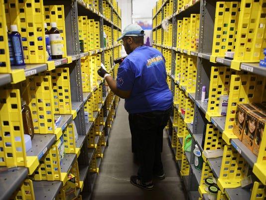 Amazonís stock crosses $1,000 mark amid Wall Street love fest