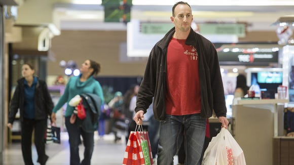 Frank Russo walks through Christiana Mall after doing some Christmas shopping for his wife and kids in this  2013 file photo.