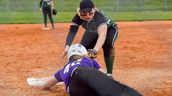 James Buchanan's Taryn Miller tries to tag out Chole Bartram of Northern York as she slide into the bases during a girls softball game on Thursday, March 30, 2016 in Mercersburg, Pa. Bartram was safe.