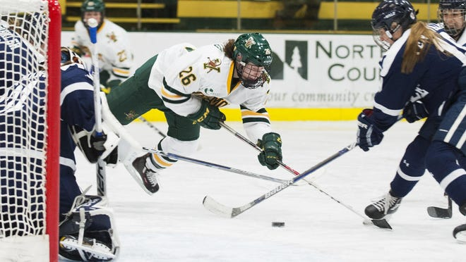 Vermont's Eve-Audrey Picard (26) is tripped up in front of the net during the women's hockey game between the Yale Bulldogs and the Vermont Catamounts on Dec. 31 in Burlington.
