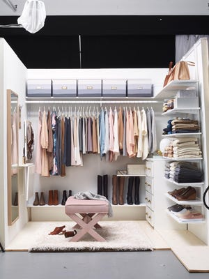 Adding labels to lidded bins saves time when you're looking for tucked-away items. Left, a full-length mirror turns a closet into a one-stop dressing room. Storing shoes off the floor gives the space a cleaner appearance.