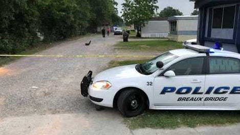 Police investigate a shooting in Breaux Bridge Wednesday morning.