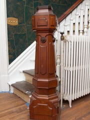 The newel post at the foot of the stairs leading from