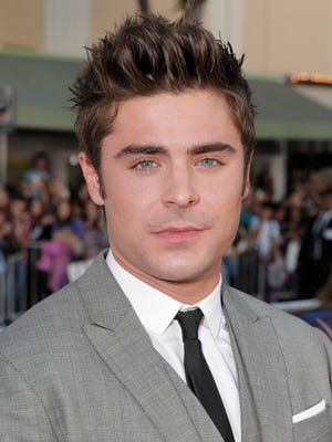 """Zac Efron seen here arriving at the world premiere of """"Neighbors"""" at the Regency Village Theatre on Monday, April 28, 2014, in Los Angeles, posted a selfie of him in Palm Springs this past weekend."""