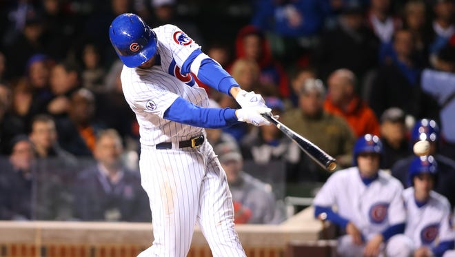 Kris Bryant hits a single during the fifth inning.