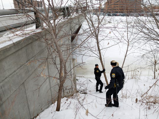Green Bay Police  Officers Barb Gerarden (left) and Tracy Liska check under the University Avenue bridge following a report that a homeless person was sleeping there. The officers are on a special mental-health assignment that seeks to connect the mentally ill with treatment and other help.