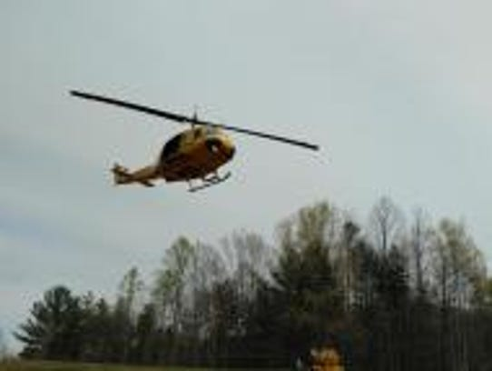 Firefighters use a helicopter to track the growth of