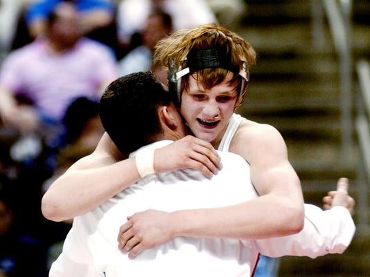 Bermudian Springs' Rickey Schmelyun gets a hug from coach Dave McCollum after winning the 140-pound state championship match Saturday against Aaron Nestor of Reynolds. (3/12/2006 DAILY RECORD / SUNDAY NEWS — JAMES ROBINSON)